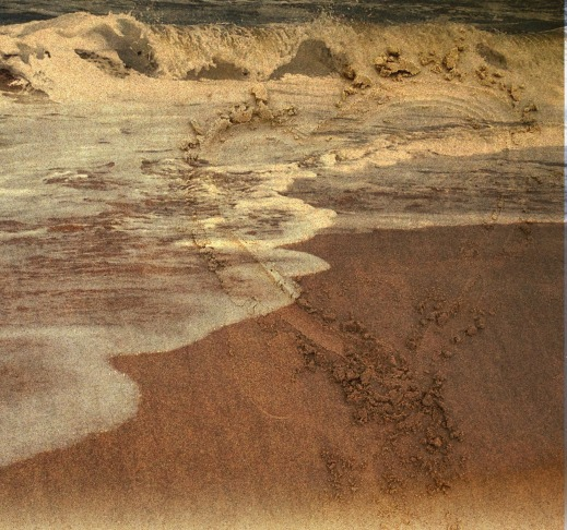 sand heart in ocean