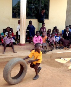 boy with tire at Mercy school